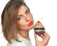 Woman enjoy chocolate cup cake dessert with cherry. Unhealthy junk food concept isolated on a white background Stock Image