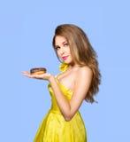 Woman enjoy chocolate donut cake Stock Photos