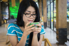 Woman enjoy coffee at cafe Stock Image