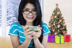 Woman enjoy coffee at home at christmas day Stock Image