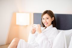 Woman enjoy coffee in morning. Beauty asian woman drink coffee and enjoy a wonderful morning in the hotel royalty free stock photography