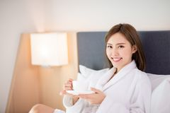 Woman enjoy coffee in morning. Beauty asian woman drink coffee and enjoy a wonderful morning in the hotel royalty free stock photo