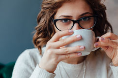 Woman enjoy in cup of hot coffee Royalty Free Stock Image