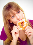 Woman enjoy donut cake. Unhealthy junk food concept Royalty Free Stock Photo