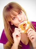 Woman enjoy donut cake. Unhealthy junk food concept Royalty Free Stock Photo