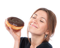Woman enjoy donut. Unhealthy junk food concept Royalty Free Stock Photography