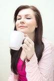 Woman enjoy drink with a cup Stock Photos