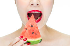 Woman enjoy eating watermelon with red lips, Nail Polish Royalty Free Stock Photos