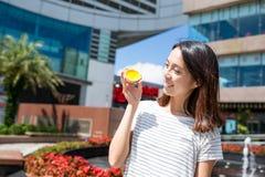 Woman enjoy the egg tart in Hong Kong Stock Image