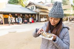 Woman enjoy famous oyster in Itsukushima. Asian young woman Stock Photos