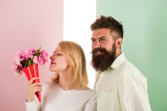 Woman enjoy fragrance bouquet flowers. Couple in love happy celebrate anniversary. Lady likes flower husband gifted her. Flowers delivery concept. Man with royalty free stock photo