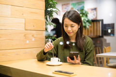 Woman enjoy her coffee with phone Stock Photos
