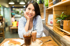 Woman enjoy her food in coffee shop Royalty Free Stock Photo
