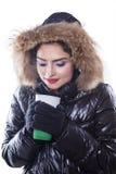 Woman enjoy hot coffee while wearing winter coat Stock Photo