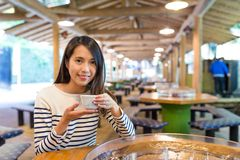 Woman enjoy hot tea in japanese restaurant. Asian young beautiful woman portrait Royalty Free Stock Photo