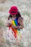 Woman enjoy life pickup flowers. Colorful dress Woman enjoy happy life in flowers garden royalty free stock photos