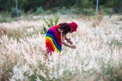 Woman enjoy life pickup flowers. Colorful dress Woman enjoy happy life in flowers garden stock photos