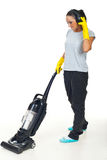 Woman enjoy music and doing housework royalty free stock photo
