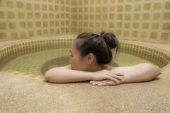Woman enjoy onsen in Japan,woman relaxing in hot springs Stock Photos