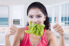 Woman enjoy raw spinach in kitchen Stock Photos