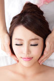 Woman enjoy receiving face massage at spa Royalty Free Stock Image