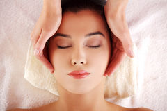 Woman enjoy receiving face massage at spa saloon Stock Photo