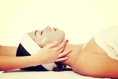 Woman enjoy receiving head massage. Beautiful young relaxed woman enjoy receiving head massage at spa saloon Royalty Free Stock Photo