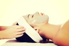 Woman enjoy receiving head massage. Beautiful young relaxed woman enjoy receiving head massage at spa saloon Royalty Free Stock Image