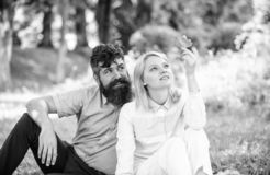 Woman enjoy relax nature background. Pure nature. Couple with green leaf relax natural environment. Couple bearded man. Woman enjoy relax nature background. Pure stock photos