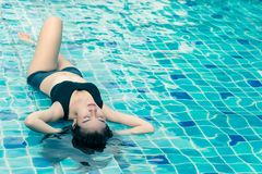 Woman enjoy and relaxing in swimming pool and copy space Stock Photo