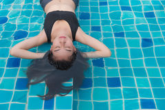 Woman enjoy and relaxing in swimming pool Stock Image