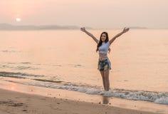 Woman enjoy on sea beach with sunset. Woman enjoy on the sea beach with sunset Stock Photo