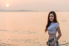 Woman enjoy on sea beach with sunset. Woman enjoy on the sea beach with sunset Royalty Free Stock Images
