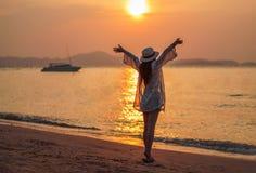 Woman enjoy on sea beach with sunset. Woman enjoy on the sea beach with sunset Royalty Free Stock Photo
