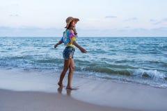 Woman enjoy on sea beach. Woman enjoy on the sea beach stock photo