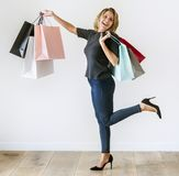 Woman enjoy shopping and carrying nags. Woman enjoy shopping and carrying bags Stock Image
