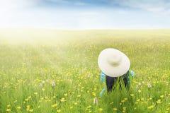 Woman enjoy springtime on meadow Stock Photos