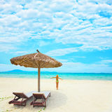 Woman enjoy sun. On the tropical beach Royalty Free Stock Images
