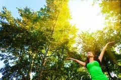 Woman enjoy the sun. Brunette woman enjoy the sun at the summer park Stock Photo