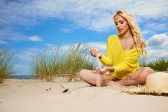 Woman enjoy sun on the beach. Young woman enjoy sun on the beach Royalty Free Stock Photography