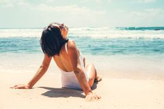 Woman enjoy with sun on beautiful sand ocean beach Stock Images