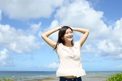 Woman enjoy the sun. Relaxed woman by the sea Royalty Free Stock Photography