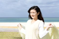 Woman enjoy the sun. The woman who relaxes on the beach Stock Photography