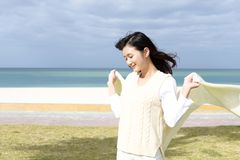 Woman enjoy the sun. The woman who relaxes on the beach Royalty Free Stock Image