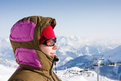 Woman enjoy sun in winter. Woman enjoying sun in winter on summit in alps Royalty Free Stock Photography