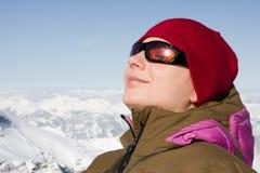 Woman enjoy sun in winter stock image