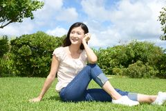 Woman enjoy the sun. Young woman relaxing at the park Stock Images