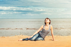 Woman enjoy sunlight on the beach Royalty Free Stock Image
