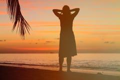 Woman enjoy sunset at tropical beach Stock Photo