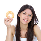 Woman enjoy sweet donut and looking at the corner. Stock Photos